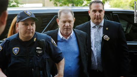 Harvey Weinstein is escorted into court, Friday, May 25, 2018, in New York. The movie mogul turned himself in at a police precinct earlier Friday.   (AP Photo/Mark Lennihan)