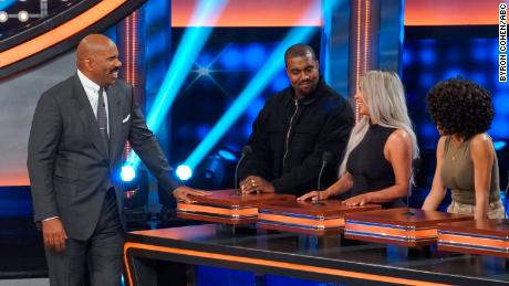 "Host Steve Harvey presides over The Kardashian Family vs. The West Family on ""Celebrity Family Feud."""