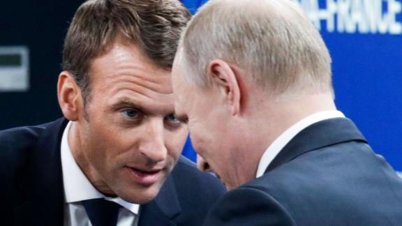 Macron and Russian President Vladimir Putin attend a meeting in St. Petersburg on May 25.