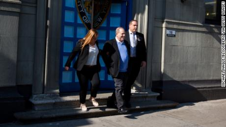 Harvey Weinstein, former co-chairman of the Weinstein Co., center, is escorted in handcuffs out of the New York Police Department (NYPD) 1st Precinct in New York, U.S., on Friday, May 25, 2018. Weinstein surrendered to authorities to face charges involving at least one of the women who have accused him of sexual assault, law enforcement officials told The Associated Press. Photographer: Michael Nagle/Bloomberg via Getty Images