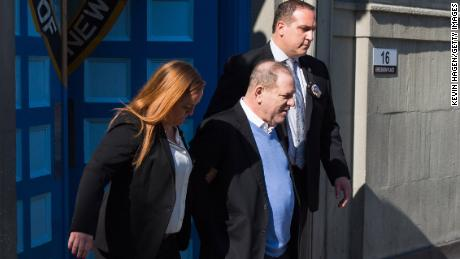 NEW YORK, NY - MAY 25:  Harvey Weinstein is led out of the New York Police Department's First Precinct in handcuffs after being arrested and processed on charges of rape, committing a criminal sex act, sexual abuse and sexual misconduct on May 25, 2018 in New York City. The former movie producer faces charges in connection with accusations made by aspiring actress Lucia Evans who has said that Weinstein forced her to perform oral sex on him in his Manhattan office in 2004. Weinstein (66) has been accused by dozens of other women of forcing them into sexual acts using both pressure and threats. The revelations of the his behavior helped to spawn the global #MeToo movement.  (Photo by Kevin Hagen/Getty Images)