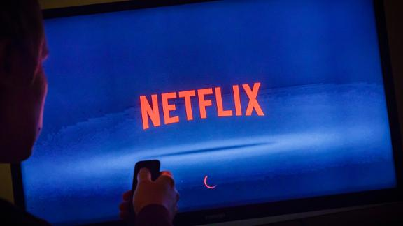 The logo of streaming service Netflix can be seen on a TV in Berlin, Germany, in this photo illustration.