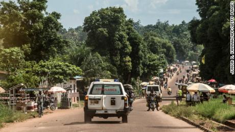 An ambulance carries the remains of an Ebola victim towards a burial site in Mbandaka, DRC.