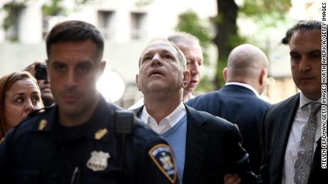 NEW YORK, NY - MAY 25:  Harvey Weinstein arrives for arraignment at Manhattan Criminal Courthouse in handcuffs after being arrested and processed on charges of rape, committing a criminal sex act, sexual abuse and sexual misconduct on May 25, 2018 in New York City. The former movie producer faces charges in connection with accusations made by aspiring actress Lucia Evans who has said that Weinstein forced her to perform oral sex on him in his Manhattan office in 2004. Weinstein (66) has been accused by dozens of other women of forcing them into sexual acts using both pressure and threats. The revelations of the his behavior helped to spawn the global #MeToo movement.  (Photo by Steven Ferdman/Getty Images)