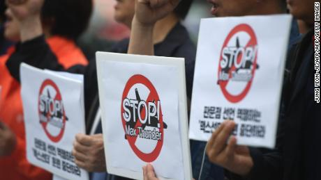 "South Korean peace activists hold placards reading ""Stop! Max Thunder,"" during a rally denouncing South Korea-US joint military drills, in front of the US embassy in Seoul on May 16, 2018."