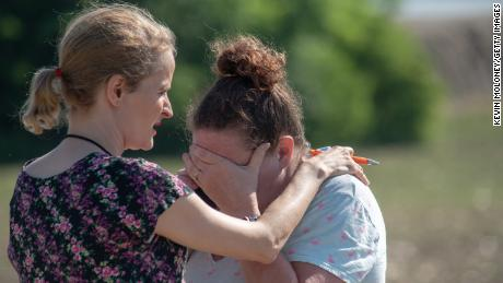 Substitute teacher Joanie Lynne consoles instructional assistant Paige Rose after the shooting.