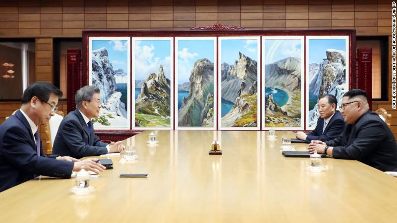 In this photo provided by South Korea Presidential Blue House via Yonhap News Agency, North Korean leader Kim Jong Un, right, and South Korean President Moon Jae-in, second from left, talk during a meeting at the northern side of the Panmunjom in North Korea, Saturday, May 26, 2018. Kim and Moon have met for the second time in a month to discuss peace commitments they reached in their first summit and Kim's potential meeting with President Donald Trump. (South Korea Presidential Blue House/Yonhap via AP)
