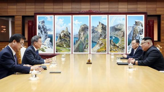 Kim Jong Un and Moon Jae-in talk during a meeting at the northern side of the Panmunjom in North Korea. It was their second face-to-face meeting.