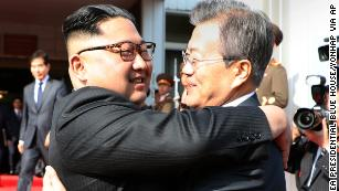 Kim Jong Un, left, and Moon Jae-in embrace after Saturday's meeting at the DMZ.