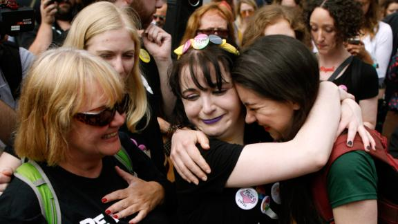 """People from the """"Yes"""" campaign react as the results of the votes begin to come in, after the Irish referendum on the 8th Amendment of the Irish Constitution at Dublin Castle, in Dublin, Ireland, Saturday May 26."""