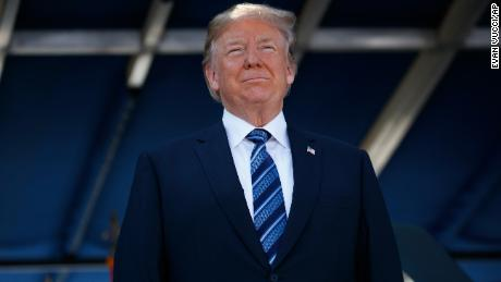 President Donald Trump listens during a graduation and commissioning ceremony at the U.S. Naval Academy, Friday, May 25, 2018, in Annapolis, Md. (AP Photo/Evan Vucci)
