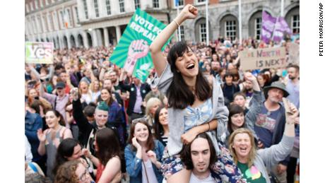 "A woman from the ""Yes"" campaign reacts after the final result was announced in the Irish referendum on the 8th Amendment of the Irish Constitution at Dublin Castle, in Dublin, Ireland, Saturday, May 26, 2018. Ireland appeared to move away from its conservative Roman Catholic roots and embrace a more liberal view Friday as two major exit polls predicted voters had repealed a constitutional ban on abortion. (AP Photo/Peter Morrison)"