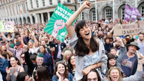 """A woman from the """"Yes"""" campaign reacts after the final result was announced in the Irish referendum on the 8th Amendment of the Irish Constitution at Dublin Castle, in Dublin, Ireland, Saturday, May 26, 2018. Ireland appeared to move away from its conservative Roman Catholic roots and embrace a more liberal view Friday as two major exit polls predicted voters had repealed a constitutional ban on abortion. (AP Photo/Peter Morrison)"""