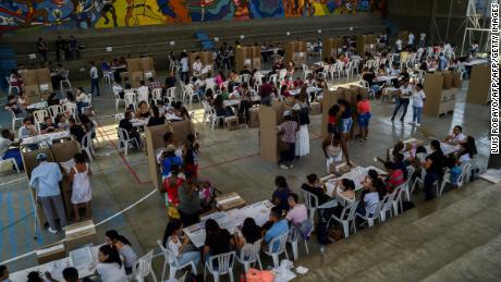 General view of a polling station in Cali, Valle del Cauca Department, during parliamentary elections in Colombia on March 11, 2018. Colombians went to the polls Sunday to elect a new Congress with a resurgent right, bitterly opposed to a peace deal that allows leftist former rebels to participate, expected to poll strongly. The election is set to be the calmest in half a century of conflict in Colombia, with the former rebel movement FARC spurning jungle warfare for politics, and the ELN -- the country's last active rebel group -- observing a ceasefire.  / AFP PHOTO / Luis ROBAYO        (Photo credit should read LUIS ROBAYO/AFP/Getty Images)