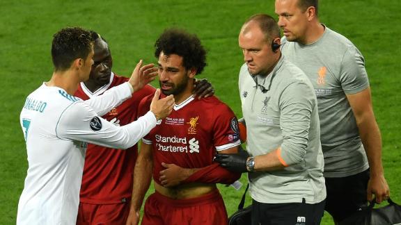 Ronaldo (left) consoles Liverpool's Mo Salah as he went off injured.