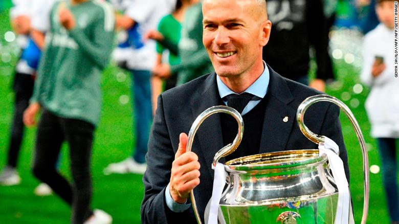 Zinedine Zidane poses with the Champions League trophy after the 2018 final against Liverpool.