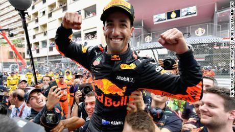 Race winner Daniel Ricciardo celebrates on the podium after claiming his maiden victory in the Monaco GP.