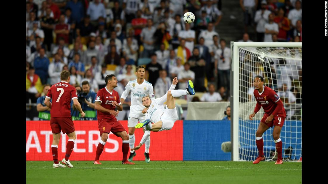 "Gareth Bale of Real Madrid scores his second goal during the <a href=""http://bleacherreport.com/articles/2778051-gareth-bale-heroics-give-real-madrid-champions-league-final-win-vs-liverpool"" target=""_blank"">UEFA Champions League Final </a>between Real Madrid and Liverpool at NSC Olimpiyskiy Stadium in Kiev, Ukraine, on Saturday, May 26."