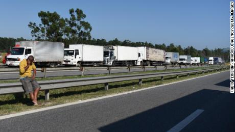 Truck drivers block a road near Rio Friday.