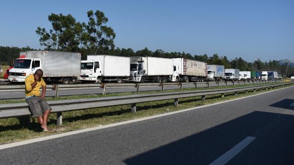 Truck drivers block a road near Rio Friday.
