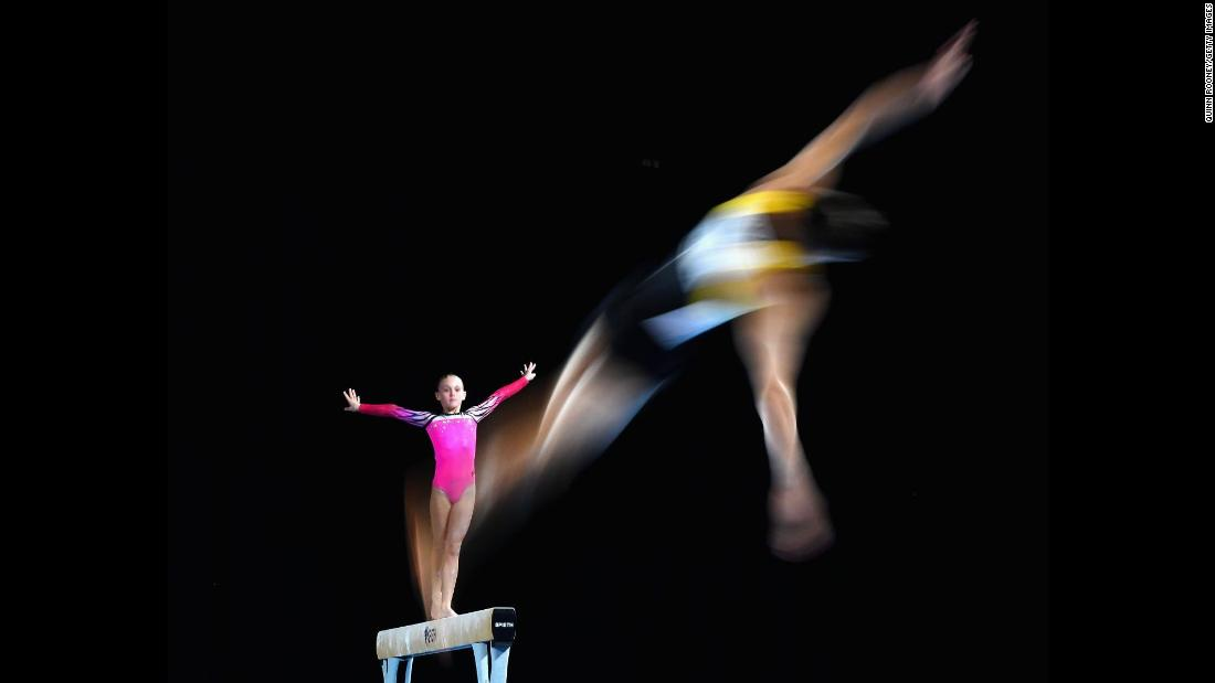 Tyarn Lees of New South Wales competes on the beam as Ryan Inouye of Western Australia competes on the floor during the 2018 Australian Gymnastics Championships at Hisense Arena in Melbourne, Australia, on Tuesday, April 22.