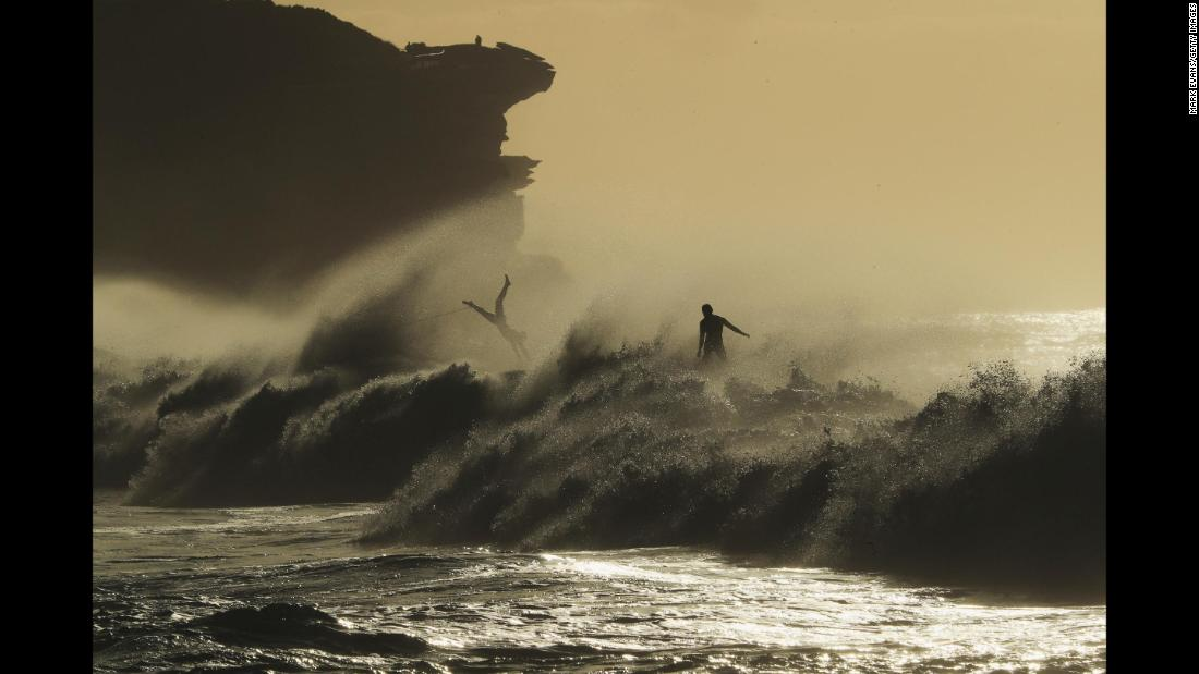 Surfers take advantage of a large swell at Bronte Beach in Sydney, Australia, on Saturday, May 26.