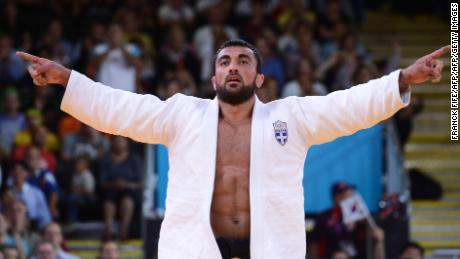 Greece's Ilias Iliadis celebrates after winning his men's -90kg judo contest bronze medal match of the London 2012 Olympic Games on August 1, 2012 at the ExCel arena in London. AFP PHOTO / FRANCK FIFE        (Photo credit should read FRANCK FIFE/AFP/GettyImages)