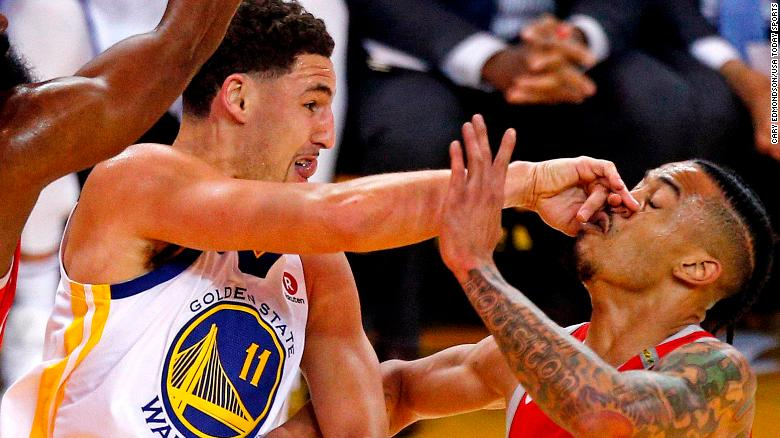 May 26, 2018; Oakland, CA, USA; Golden State Warriors guard Klay Thompson (11) passes the ball against Houston Rockets guard Gerald Green (14) during the first quarter in game six of the Western conference finals of the 2018 NBA Playoffs at Oracle Arena. Mandatory Credit: Cary Edmondson-USA TODAY Sports