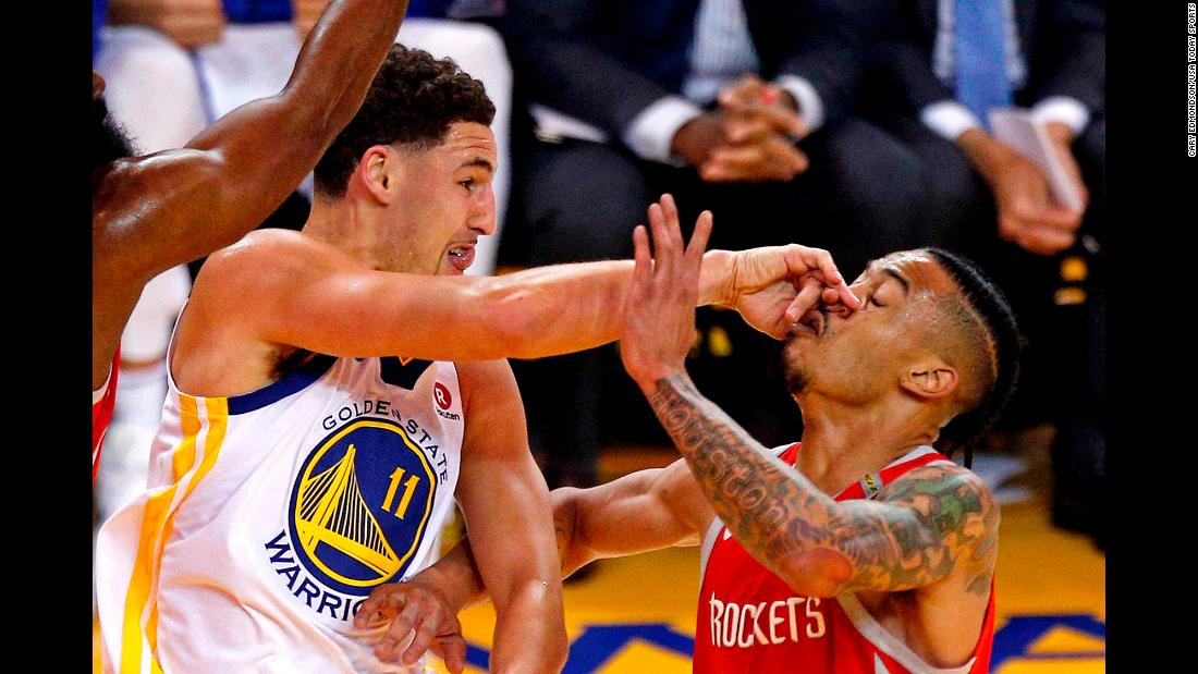 Golden State Warriors guard Klay Thompson passes the ball against Houston Rockets guard Gerald Green in game six of the NBA's Western Conference finals in Oakland, California, on Saturday, May 26.