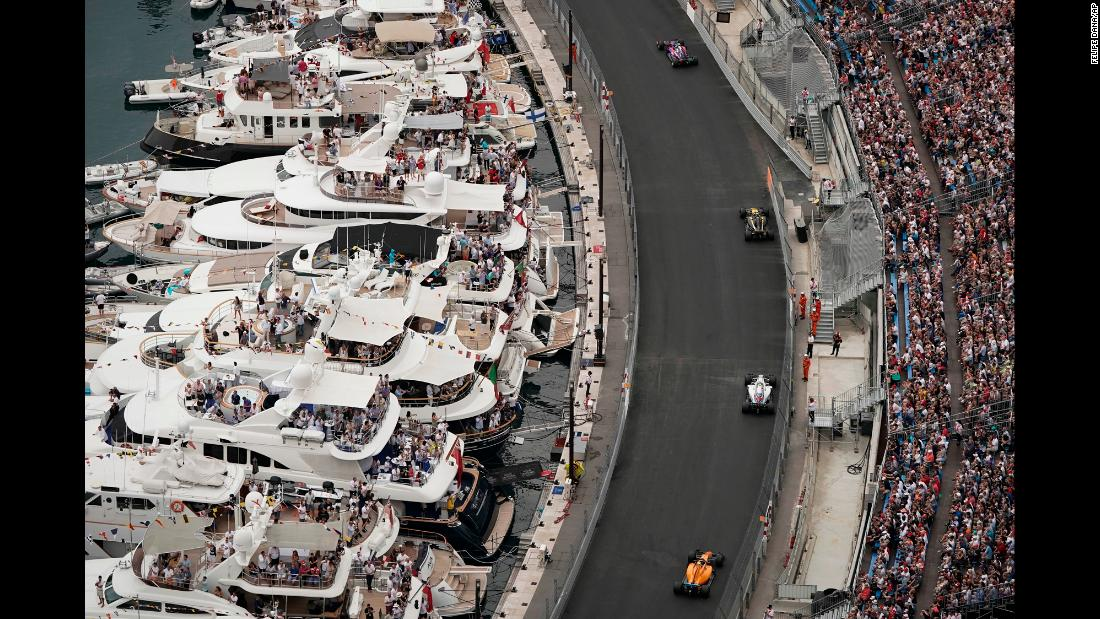 Fans watch from yachts as Formula One drivers speed along the wall during the Monaco Formula One Grand Prix in Monaco, Sunday, May 27.