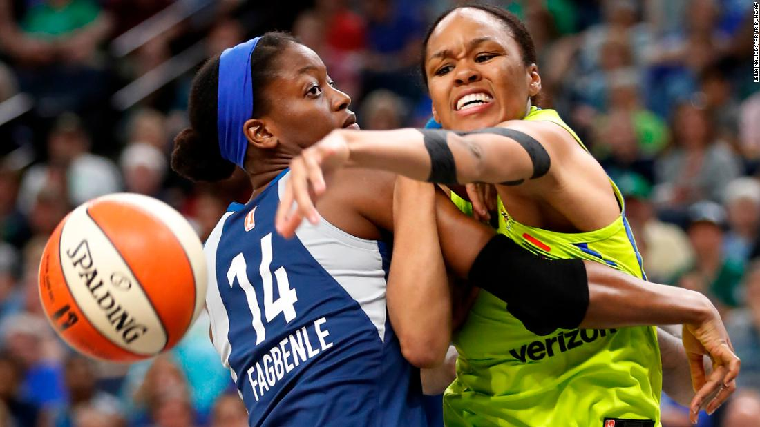 Minnesota Lynx forward Temi Fagbenle (14) and Dallas Wings forward Azura Stevens (30) fight for a rebound during a WNBA basketball game in Minneapolis, on Wednesday, May 23.