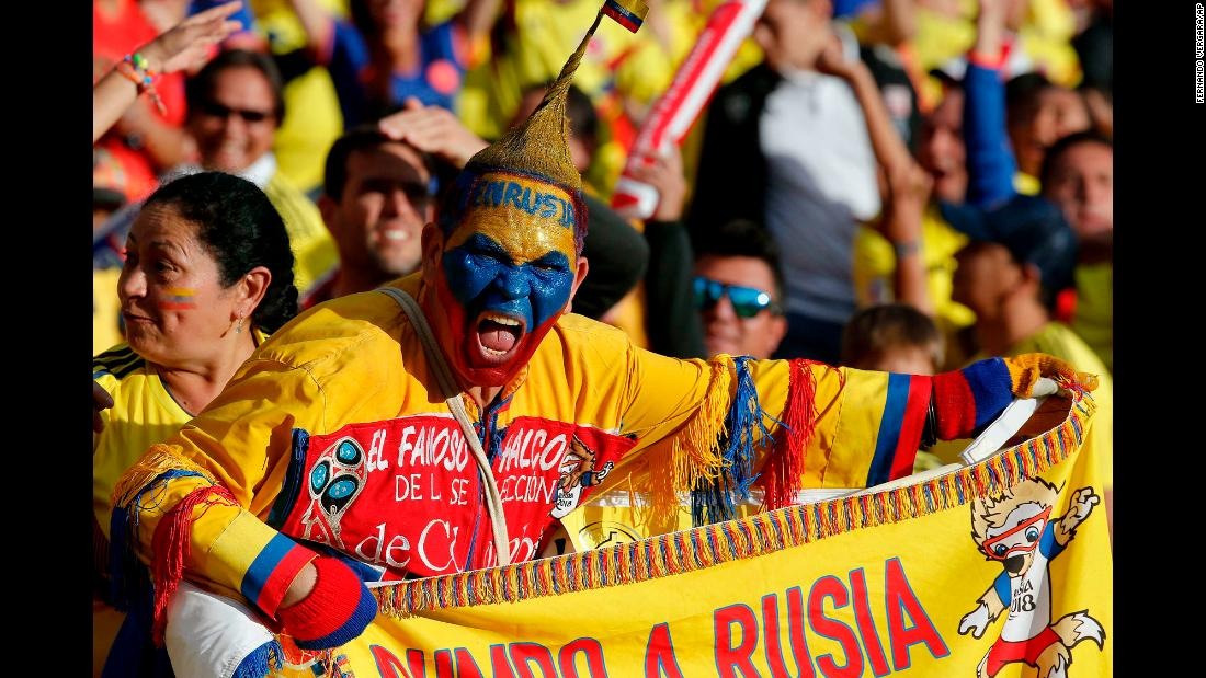 A fan of the Colombia national soccer team cheers from the stands during a farewell exhibition game at the Nemesio Camacho stadium in Bogota, Colombia, on Friday, May 25. Colombia will also play a friendly match against Egypt in Italy before heading to Russia for the 2018 FIFA World Cup.