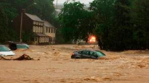 Water rushes through Main Street in Ellicott City, Md., Sunday, May 27, 2018. Flash flooding and water rescues are being reported in Maryland as heavy rain soaks much of the state. (Kenneth K. Lam/The Baltimore Sun via AP)