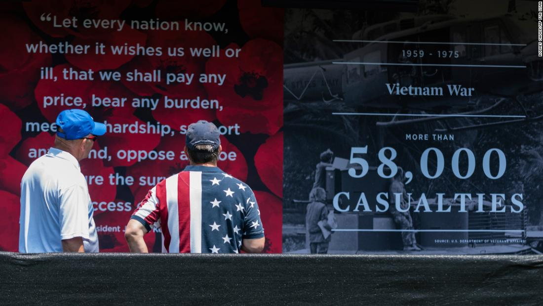 "Visitors at the ""Poppy Memorial"", a temporary memorial made by USAA consisting of more than 645,000 poppy flowers, with each flower honoring each man and woman who gave their life in military service to the US since World War I, at the National Mall on Saturday, May 26, 2018 in Washington. (Rodney Choice/AP Images for USAA)"