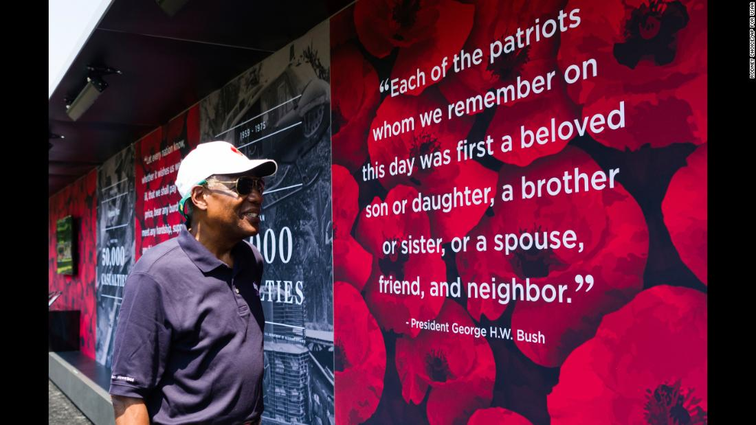 "United States Air Force General (Ret.) and USAA Chairman Lester L. Lyles observes exhibit at the ""Poppy Memorial,"" on Saturday, May 26, 2018 in Washington. (Rodney Choice/AP Images for USAA)"