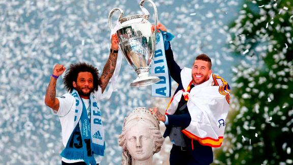 Marcelo and Sergio Ramos hold the Champions League trophy at Cibeles square in Madrid.