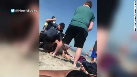 Screengrab from a bystander's video of Wildwood, N.J., police attempting to subdue Emily Weinman, 20, of Philadelphia