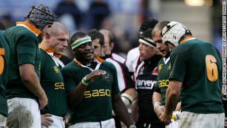 Mahlatse 'Chiliboy' Ralepelle (C) talks to his team during a match against a World XV in 2006.