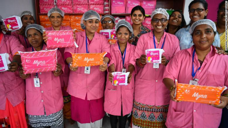Women working for Myna Mahila Foundation in Mumbai show the sanitary pads they make and distribute.