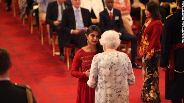 Suhani Jalota receiving a Queen's Young Leaders Award from Queen Elizabeth II at Buckingham Palace on June 29, 2017.