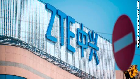 "This picture taken on May 3, 2018 shows the ZTE logo on an office building in Shanghai. - Chinese telecom giant ZTE said its major operations had ""ceased"" following last month's US ban on American sales of critical technology to the company, raising the possibility of its collapse. (Photo by Johannes EISELE / AFP)        (Photo credit should read JOHANNES EISELE/AFP/Getty Images)"