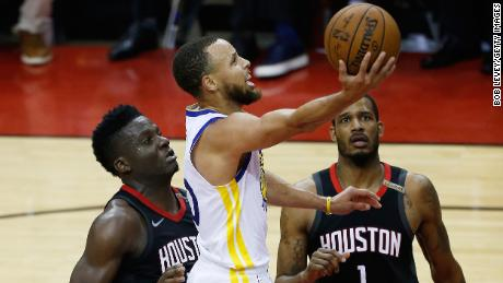 HOUSTON, TX - MAY 28:  Stephen Curry #30 of the Golden State Warriors goes up against Clint Capela #15 and Trevor Ariza #1 of the Houston Rockets in the second quarter of Game Seven of the Western Conference Finals of the 2018 NBA Playoffs at Toyota Center on May 28, 2018 in Houston, Texas. NOTE TO USER: User expressly acknowledges and agrees that, by downloading and or using this photograph, User is consenting to the terms and conditions of the Getty Images License Agreement.  (Photo by Bob Levey/Getty Images)