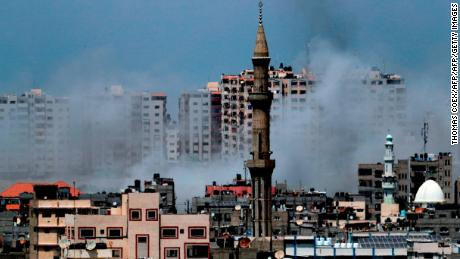 A picture taken from Gaza City on May 29, 2018, shows a smoke billowing in the background following an Israeli air strike on the Palestinian enclave. - Israel struck bases of militant groups in the Gaza Strip, the enclave's Islamist rulers Hamas said, hours after nearly 30 mortar shells were fired at the Jewish state. (Photo by THOMAS COEX / AFP)        (Photo credit should read THOMAS COEX/AFP/Getty Images)
