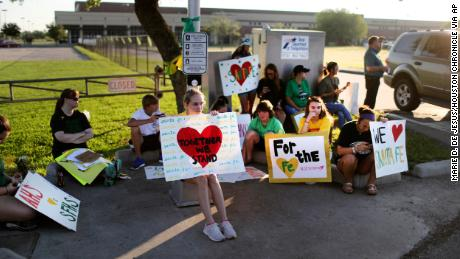 Supporters gather by Santa Fe High for the resumption of classes Tuesday.