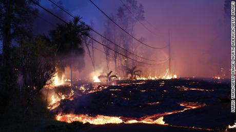 Lava from a Kilauea volcano fissure moves up a residential street in Leilani Estates.