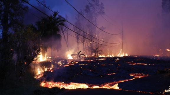 PAHOA, HI - MAY 27:  Lava from a Kilauea volcano fissure advances up a residential street in Leilani Estates, on Hawaii