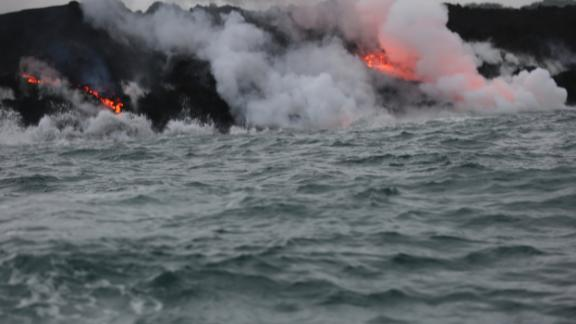 Lava continues to flow into the ocean off of the cost of Hawaii near Pahoa.The lava can be seen dripping into the ocean as waves crash against the seawall.