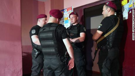 Police guard the building where Arkady Babchenko was shot dead, in Kiev, on Tuesday.