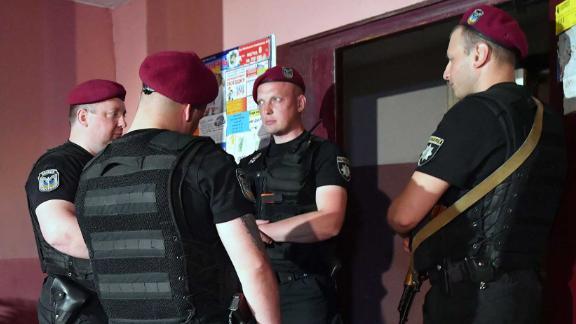 Police guard the building where Arkady Babchenko was shot dead on Tuesday.