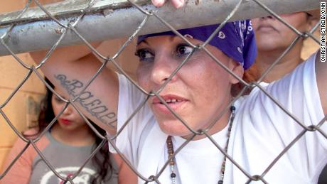 Roxana, photographed wearing a blue bandana, said she has retired from gang culture.